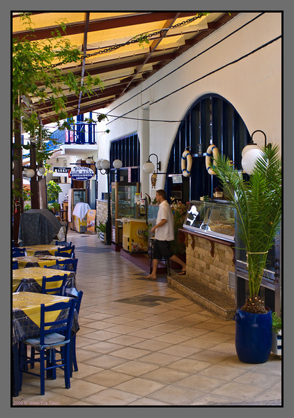 """""""Main street"""" in Loutro - passing through numberous restaurants and hotels"""