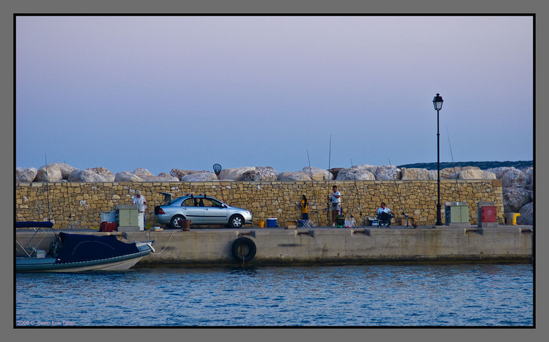 Fishing at the jetty, Karave harbour