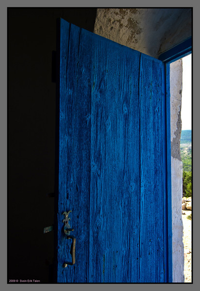 The chapel door - blue, and weather beaten - and always open to visitors