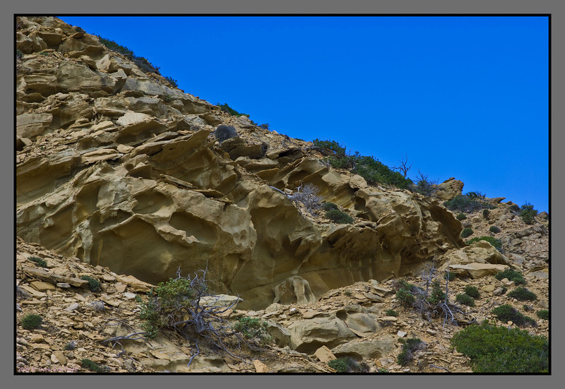 Ground structure - wildly sculpted hillside above Agios Ioannis beach