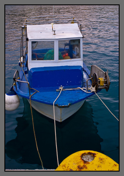 Small fishing boat in Karave harbour