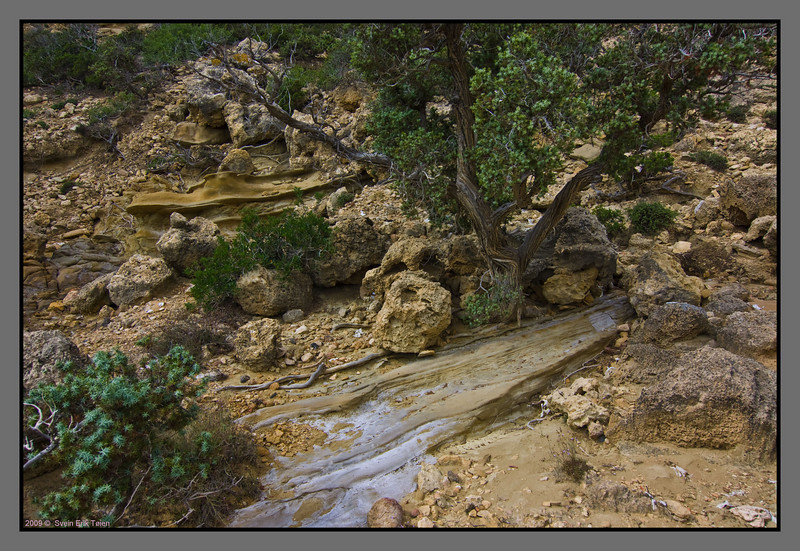 Ground structure - layered and eroded hillside above Agios Ioannis beach