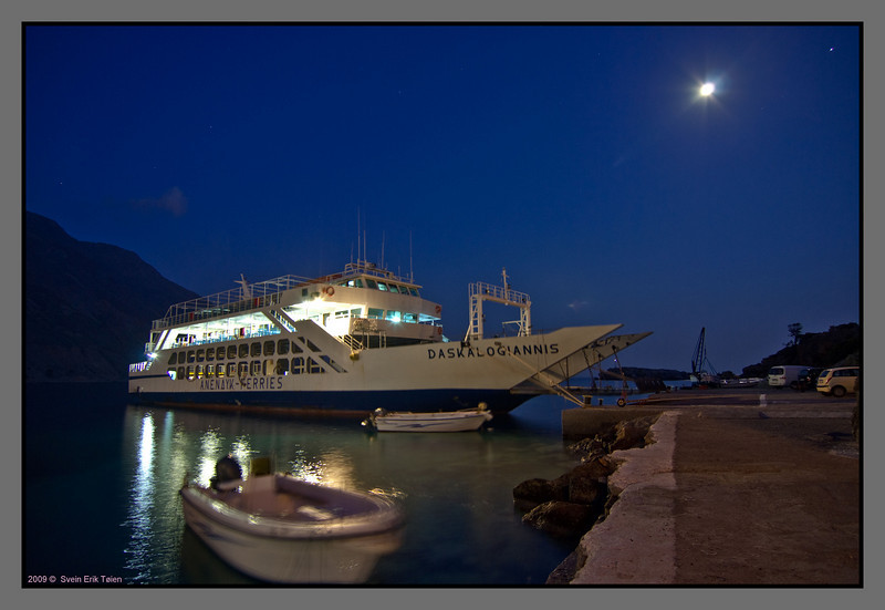 Ferry at rest - making a wall closing the space in Loutro bay at night