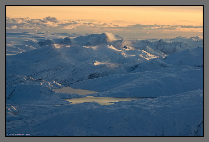 Approaching Bodø - snowdrift on the mountain peaks by the glacier Svartisen