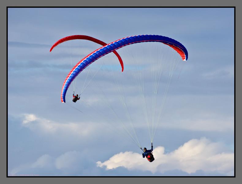 Dual wings<br /> Paragliders over Keiservarden, Bodø