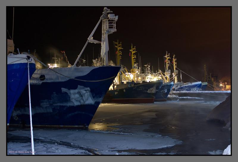 Arctic fishing fleet<br /> Russian trawlers at Kirkenes harbour, -25 C