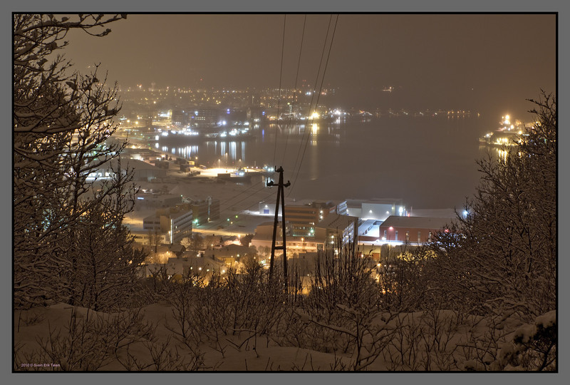 Snow over town<br /> Bodø harbour seen from Linken