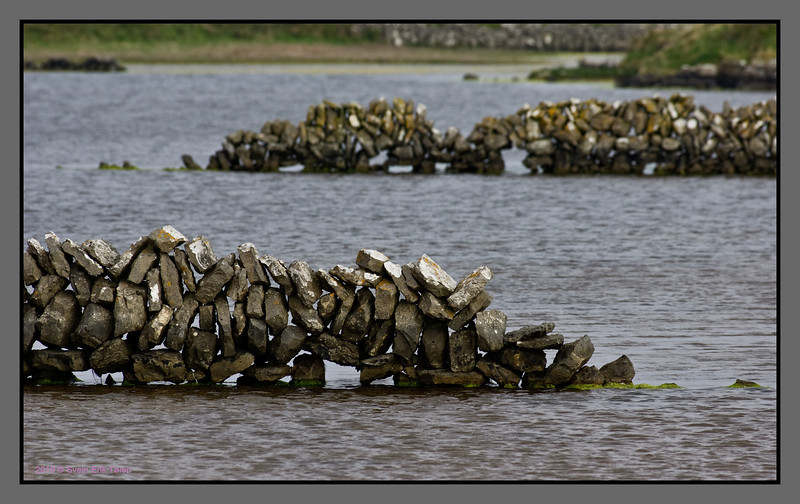 Rocking across water<br /> Stone fences in small lake, Kilronan