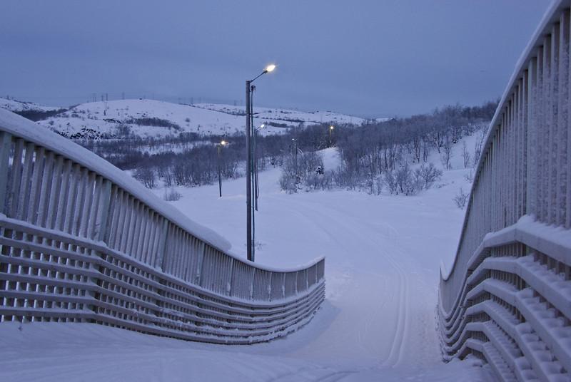 Curves - mid day dusk<br /> Lighted ski track bridge, Kirkenes