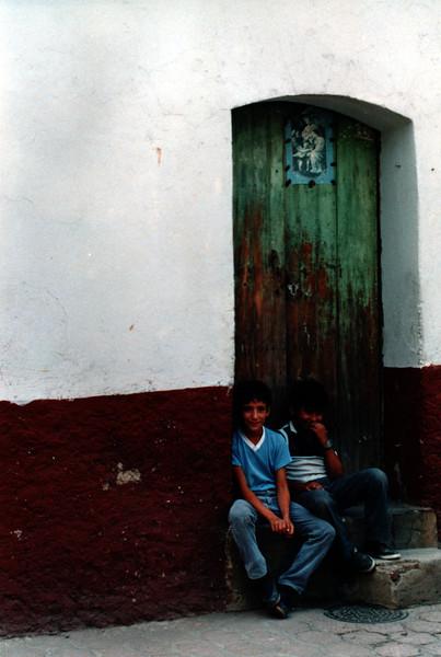 Boys in doorway, Guadalajara, Mexico
