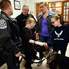 Meadow and Daisy Narkin pet Jerry, while K-9 officer Bryan Nawoschik chats with fellow K-9 Officer Christopher Narkin and his wife, Lisa, during a fundraiser at Maenner Chor Club May 13, 2017.