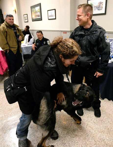 """K-9 officer Bryan Nawoschik's partner, Jerry, gets wildly excited when he sees """"foster parents,"""" Vicki Berkowitz during a fundraiser at Maenner Chor Club May 13, 2017.  (Bob Raines/Digital First Media)"""