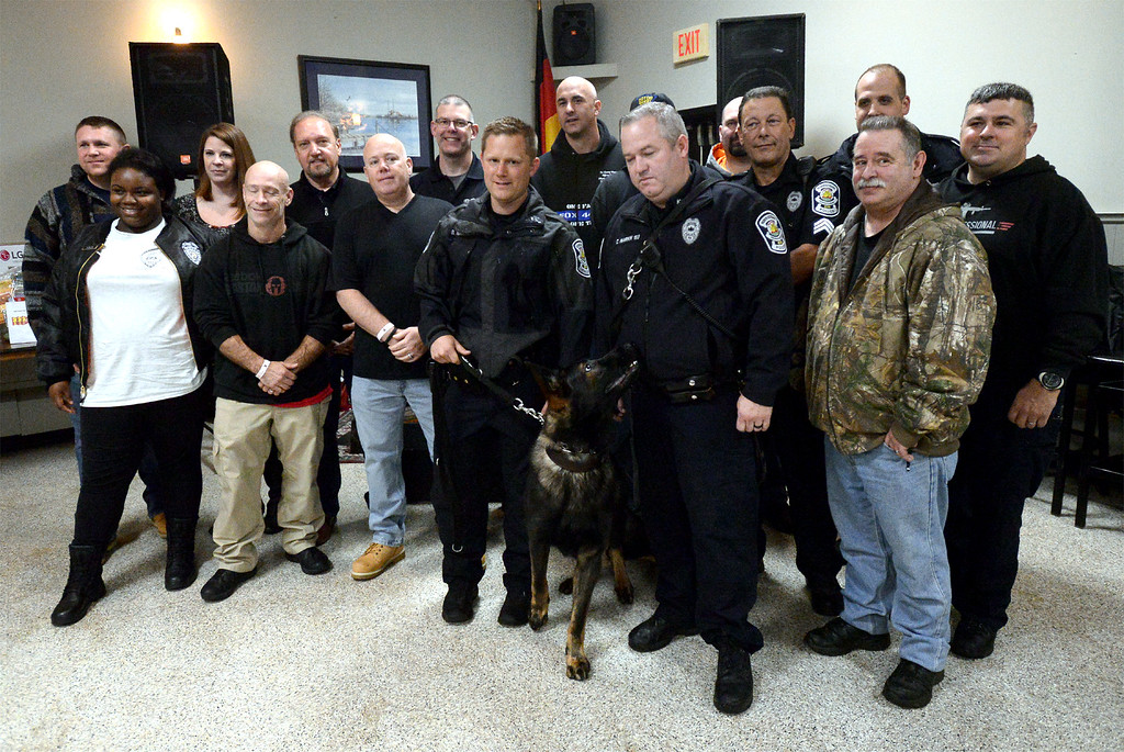 . Norristown police officers join K-9 officer Bryan Nawoschik and his partner, Jerry, at a fundraiser at Maenner Chor Club May 13, 2017.  (Bob Raines/Digital First Media)