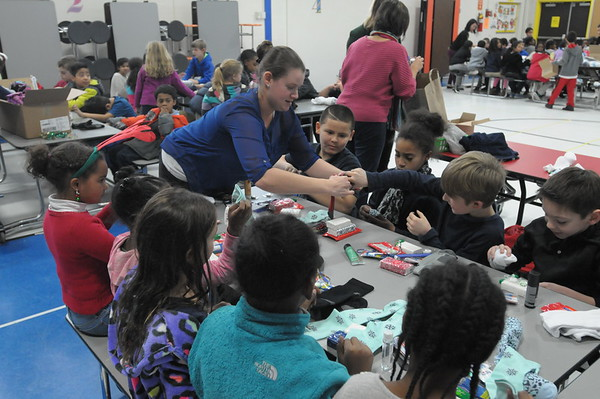 3rd graders at Cole Manor elementary school stuff socks with toiletries and candy