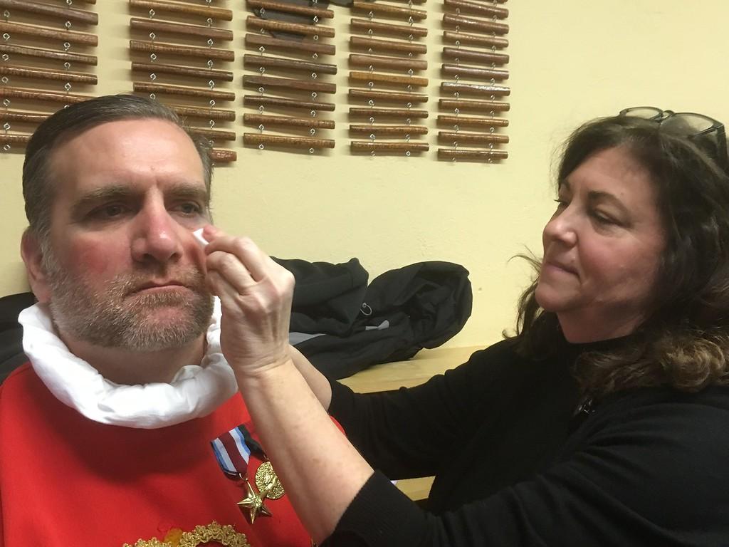 . Maggie Antenucci applies Jack Melillo\'s makeup before the Boar\'s Head and Yule Log Festival at St. Peter\'s Lutheran Church, Whitemarsh, Saturday, Jan. 6, 2018. (Joe Barron � Digital First Media)