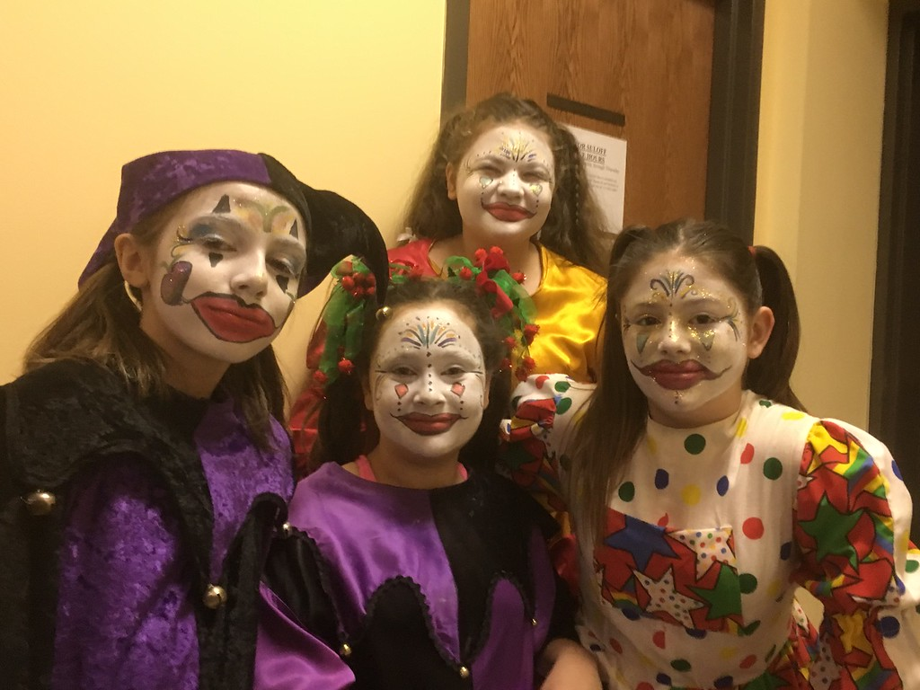 . Jesters, from left, Leah Saffell, Brianna Devlin, Eva Friedgen and Grace Stumpf pose for a photo before the Boar\'s Head and Yule Log Festival at St. Peter\'s Lutheran Church, Whitemarsh, Saturday, Jan. 6, 2018.  (Joe Barron � Digital First Media)