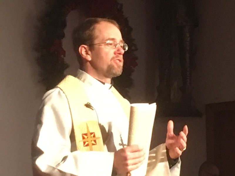 The Rev. Christian McMullen, pastor of St. Peter's Lutheran Church, Whitemarsh, introduces the Boar's Head and Yule Log Festival Saturday, Jan. 6, 2018. (Joe Barron ― Digital First Media)