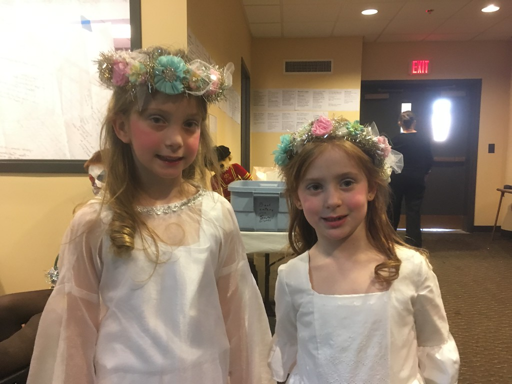 . Sisters Claire, left, and Erin Reed pose for a photo before performing in the Boar\'s Head and Yule Log Festival at St. Peter\'s Lutheran Church, Whitemarsh, Saturday, Jan. 6, 2018. Claire portrayed an angel, while Erin was given the special role of the Candle Sprite. (Joe Barron � Digital First Media)
