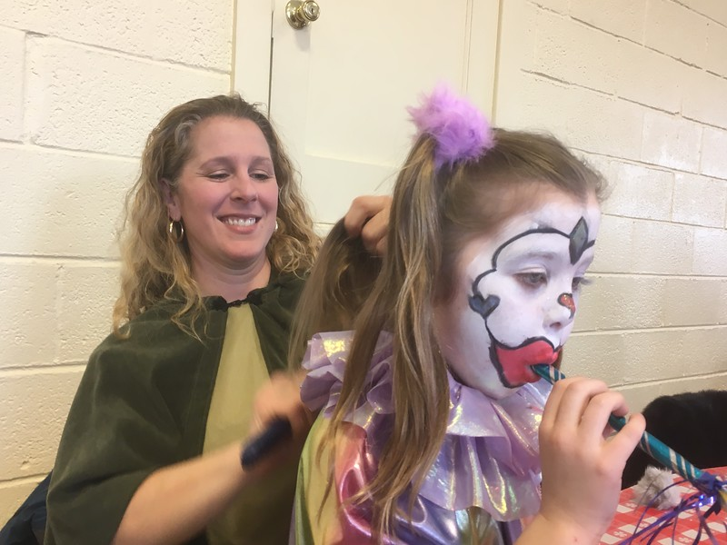 Tara Pavese brushes her daughter Natalia's hair before the first performance of the Boar's Head and Yule Log Festival at St. Peter's Lutheran Church, Whitemarsh, Saturday, Jan. 6, 2018.  (Joe Barron ― Digital First Media)