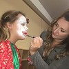 Rachel Thomas applies Skylar Terry's clown makeup before the first performance of the Boar's Head and Yule Log Festival at St. Peter's Lutheran Church, Whitemarsh, Saturday, Jan. 6, 2018.  (Joe Barron ― Digital First Media)