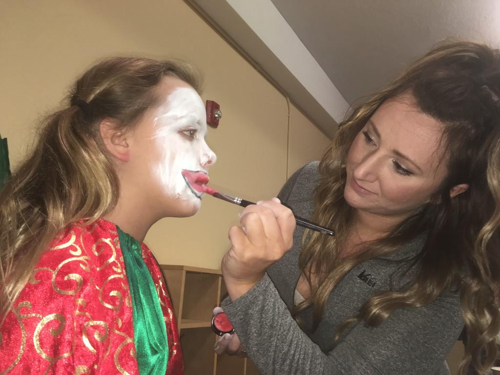 . Rachel Thomas applies Skylar Terry\'s clown makeup before the first performance of the Boar\'s Head and Yule Log Festival at St. Peter\'s Lutheran Church, Whitemarsh, Saturday, Jan. 6, 2018.  (Joe Barron � Digital First Media)