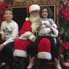 Jacob and Kayleigh Corcoran of West Chester visit jolly old St. Nick during Brunch With Santa at Elmwood Park Zoo, Norristown, Saturday, Dec. 23, 2017. (Joe Barron ― Digital First Media)