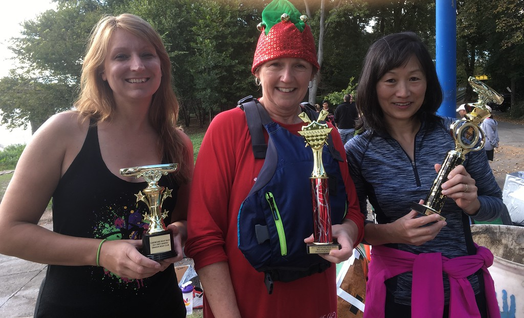 . The three winners of the Norristown Dragon Club\'s Cardboard and Duck Tape Boat Race, from left, Victoria Bulleck, Ellie Arch, adn Sylvia McDonnnell, pose with their trophies at Riverfront Park Saturday, Sept. 30, 2017. Bulleck won for best sink, and Arch for best decoration. McDonnell won the race.  Joe Barron - Digital First Media