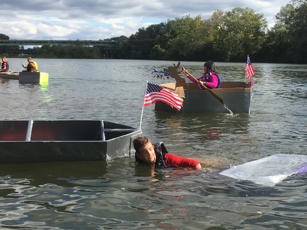 Sylvia McDonnell Passes A Foundering Competitor During The Cardboard And Duck Tape Boat Race At