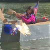 Sylvia McDonnell, Collegeville, paddles her way to victory at the Norristown Dragon Boat Club's Cardboard and Duck Tape Boat Race at River Front Park Saturday, Sept. 30, 2017. The rules of the race are simple: Boats may be constructed only of cardboard and duck tape. McDonnell's homemade boat, christened the Carnival Cruise, proved the most seaworthy vessel of the afternoon. Joe Barron - Digital First Media