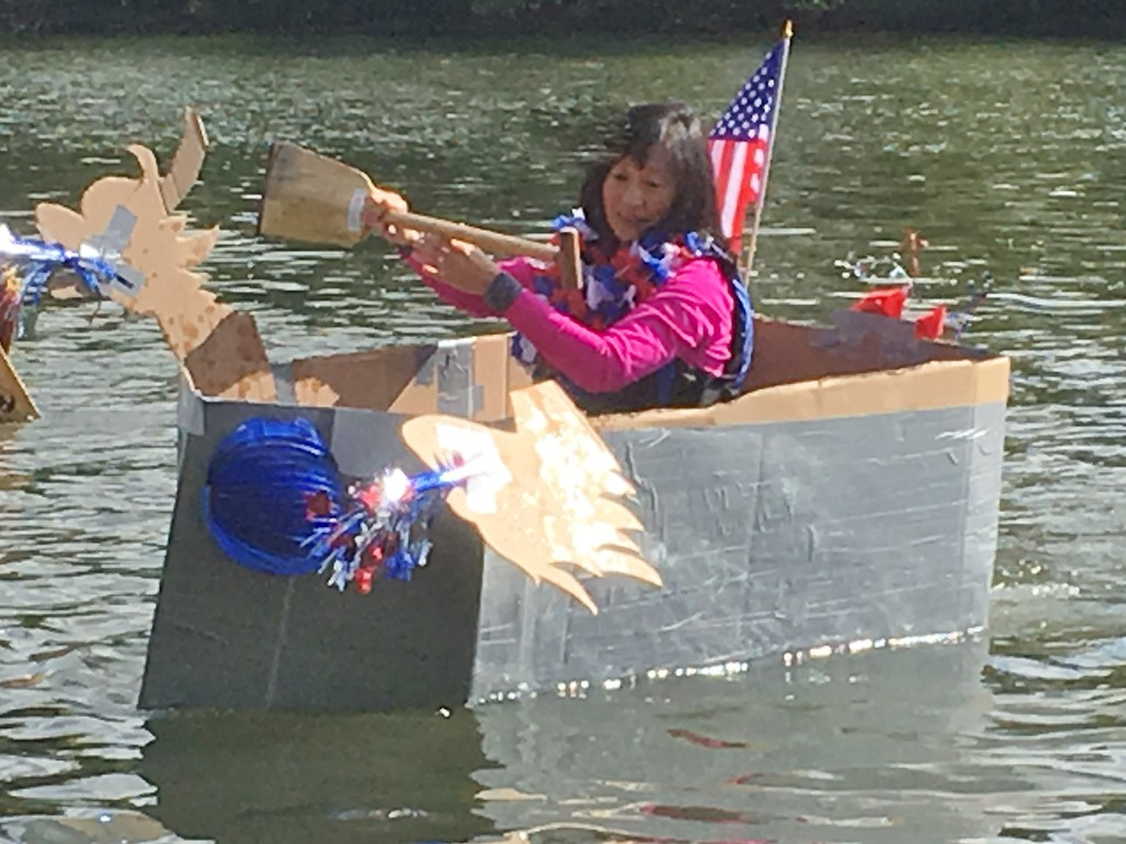 . Sylvia McDonnell, Collegeville, paddles her way to victory at the Norristown Dragon Boat Club\'s Cardboard and Duck Tape Boat Race at River Front Park Saturday, Sept. 30, 2017. The rules of the race are simple: Boats may be constructed only of cardboard and duck tape. McDonnell\'s homemade boat, christened the Carnival Cruise, proved the most seaworthy vessel of the afternoon. Joe Barron - Digital First Media