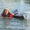 "Victoria Bulleck of Norristown holds on to her crumpled bloat after sinking in the Schuylkill River during the Dragon Boat Club's Cardboard and Duck Tape Boat Race at Riverfront Park, Norristown, Saturday, Sept. 30, 2017. Bulleck, the defending champion from last year, had to settle for the trophy for ""best sink.""  Joe Barron - Digital First Media"