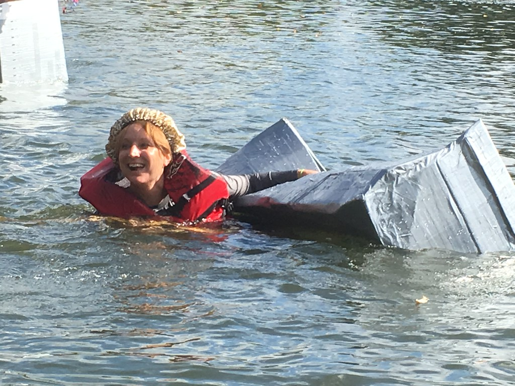 """. Victoria Bulleck of Norristown holds on to her crumpled bloat after sinking in the Schuylkill River during the Dragon Boat Club\'s Cardboard and Duck Tape Boat Race at Riverfront Park, Norristown, Saturday, Sept. 30, 2017. Bulleck, the defending champion from last year, had to settle for the trophy for \""""best sink.\""""  Joe Barron - Digital First Media"""