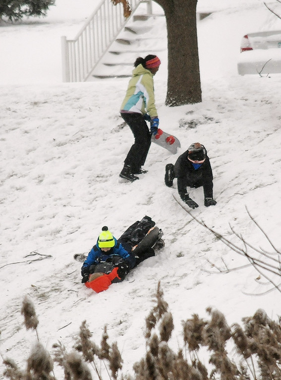 . Gene Walsh � Digital First Media Kids sled down a hill in their development in Trappe January 4, 2018.