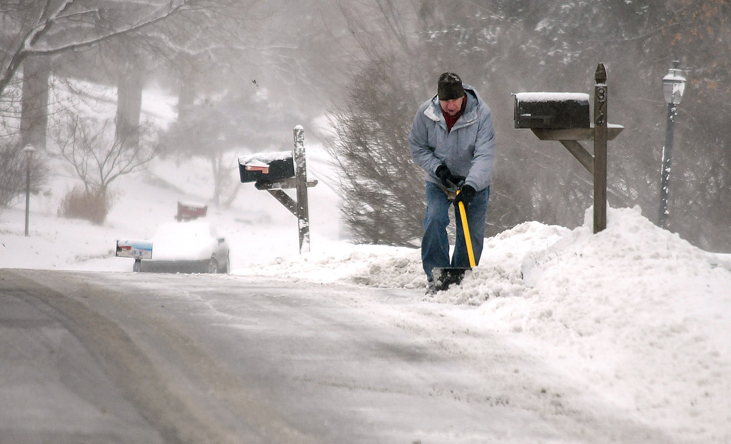 . Gene Walsh � Digital First Media Man clears his driveway of snow on Colonial Ave. in Collegeville January 4, 2018.