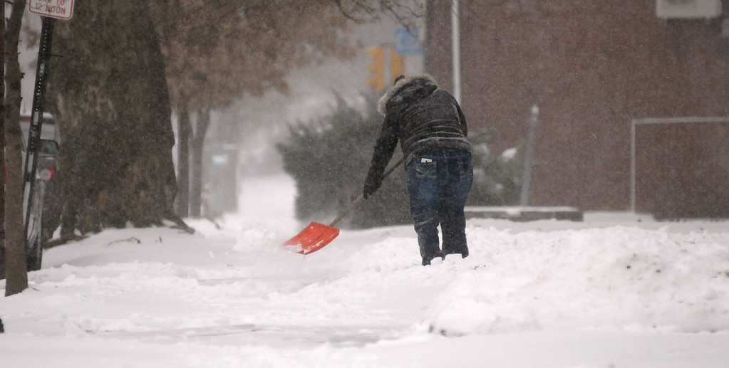 . Gene Walsh � Digital First Media Woman clears her sidewalk of snow on West Main Street in Norristown January 4, 2018.