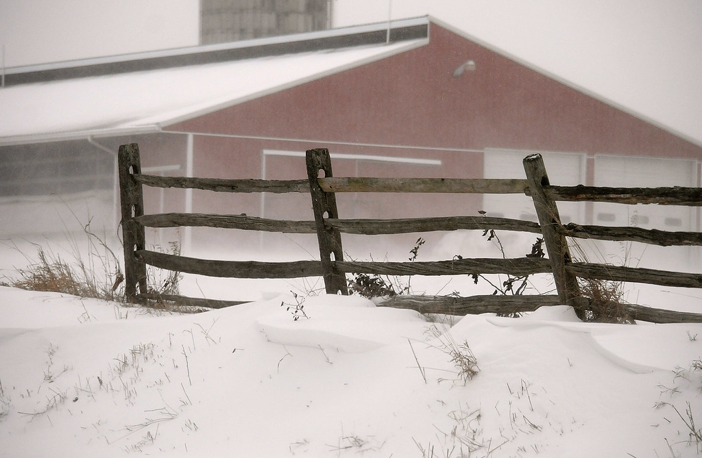 . Gene Walsh � Digital First Media Snow blows against a fence surrounding a farm along West 3rd Ave in Trappe January 4, 2018.