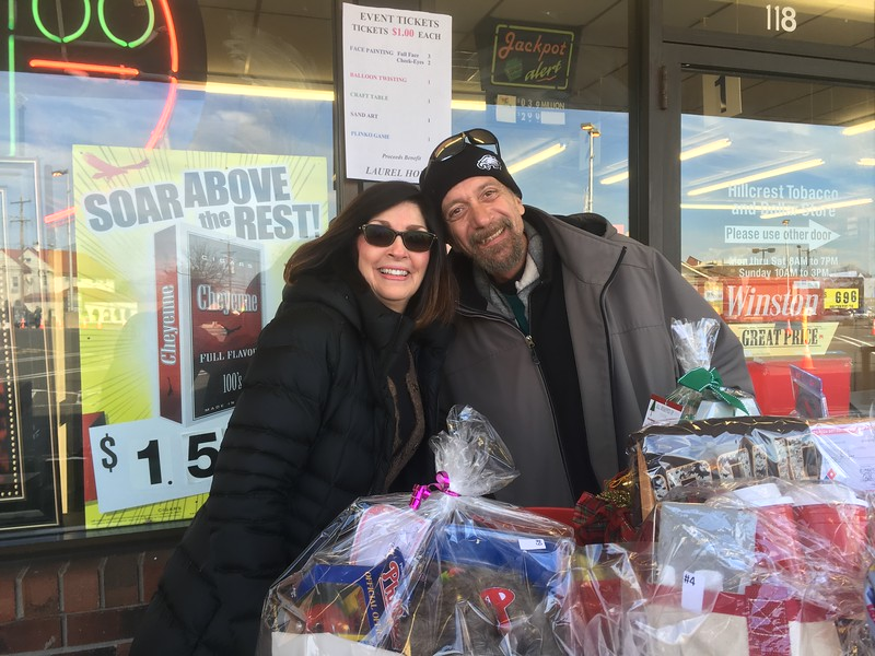 Joanne McKeon and Tom McGuffin sell raffle tickets at Hillcrest Plaza before the East Norriiton holiday parade Saturday, Dec. 2, 2017. (Joe Barron/Digital First Media)