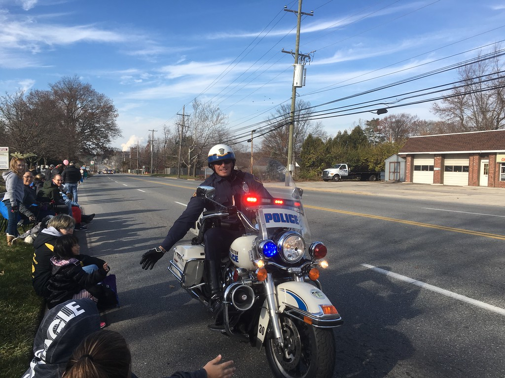 . A motorcycle cop greets tthe crowd in advance of the East Norriton holiday parade Saturday, Dec. 2, 2017. (Joe Barron/Digital First Media)