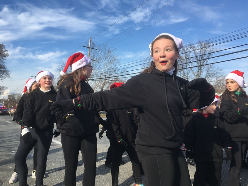 Students from the L.A. Dance Galaxy of West Norriton show off their moves on Germantown Pike Saturday, Dec. 2, 2017, during the East Norriton holiday parade. (Joe Barron/Digital First Media)
