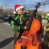 Madeleine Greenbaum plays bass with the Uptown String and during the East Norriton holiday parade Saturday, Dec. 2, 2017. (Joe Barron/Digital First Media)
