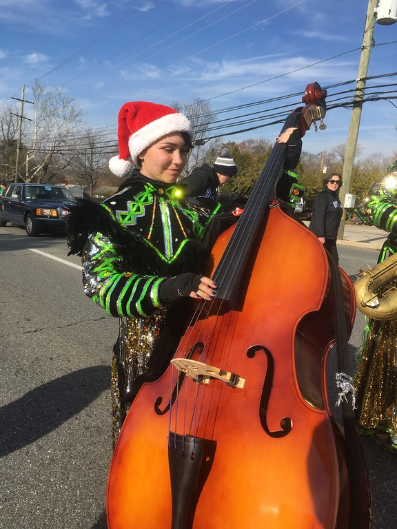 . Madeleine Greenbaum plays bass with the Uptown String and during the East Norriton holiday parade Saturday, Dec. 2, 2017. (Joe Barron/Digital First Media)