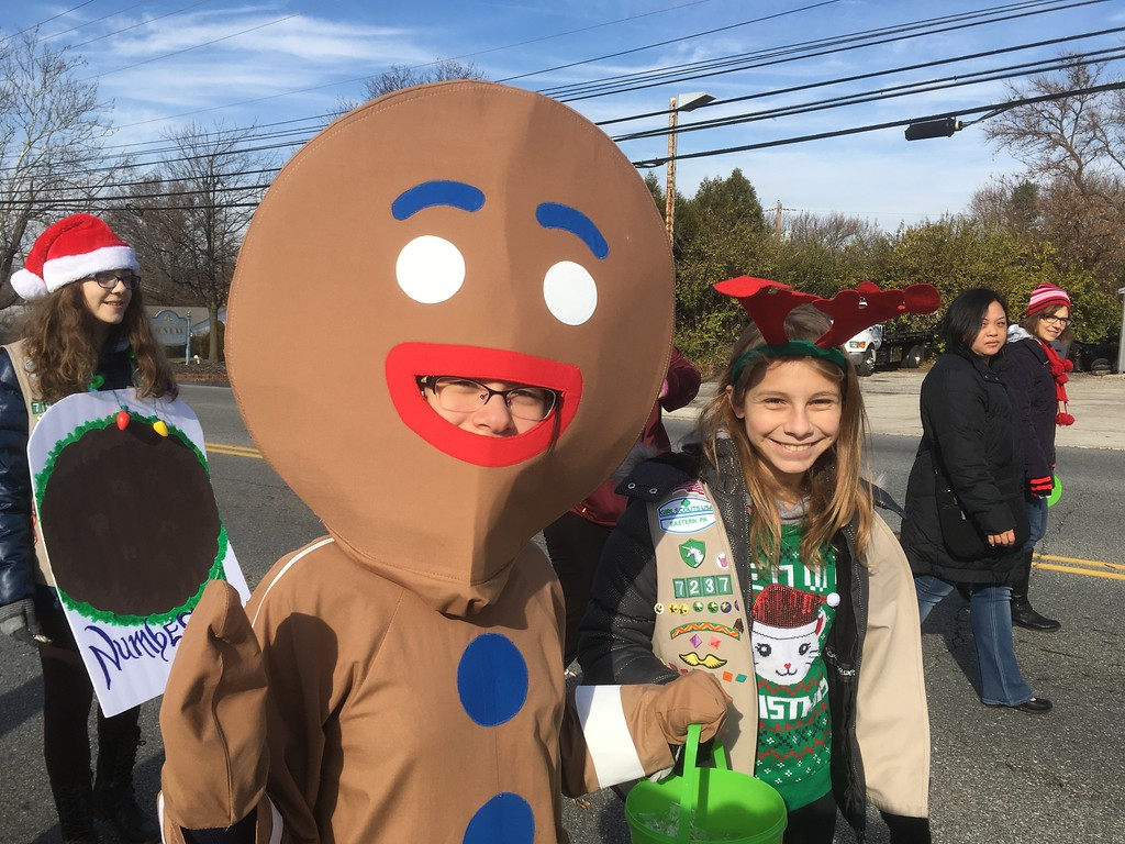. Girl Scouts march in the East Norriton holiday parade Saturday, Dec. 2, 2017. (Joe Barron/Digital First Media)