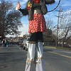 Stilt walker Samantha Hyman waves to the crowd Saturday, Dec. 2, 2017, during the East Norriton holiday parade. (Joe Barron/Digital First Media)