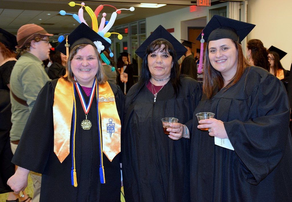. Lisa Zarzecki, AA Magna Cum Laude, Cheri Raffle AAS and Many Espinitu AAS were ready to stoll the graduate isle at MCCC 50th Commencement. Debby High for Digital First Media