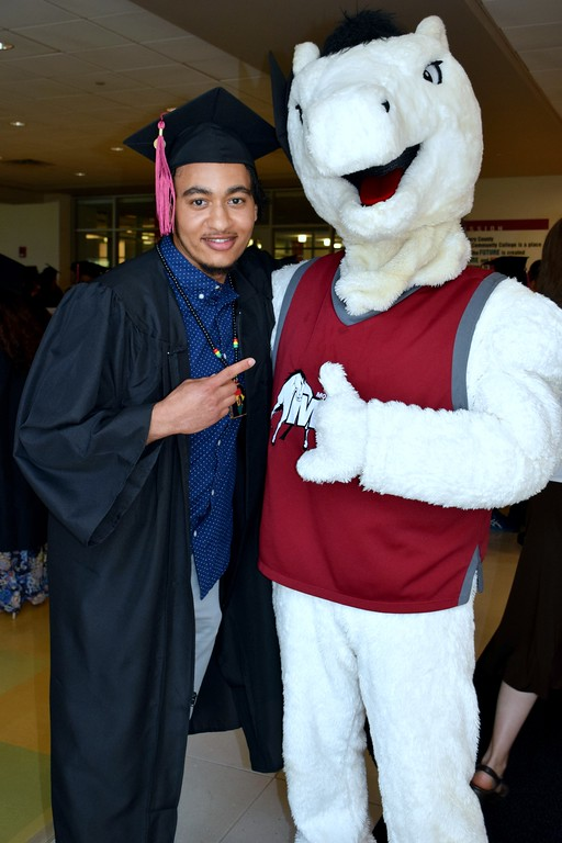 . Jahe Burton and MCCC\'s mascot the Mustangs were ready for the 50th Commencement to begin. Debby High for Digital First Media