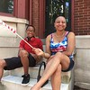 Sharon Cummings and her son Jordon watch the Norristown Fourth of July parade from a stoop on West Airy Street Tuesday, July 4, 2017. Joe Barron -- Digital First Media