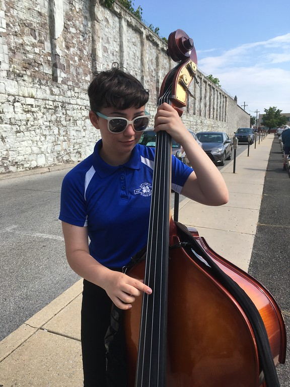 . Madeline Greenbaum, bass player for the Uptown String Band, warms up with a few riffs before the Norristown Fourth Of July parade Tuesday, July 4, 2017. Joe Barron -- Digital First Media