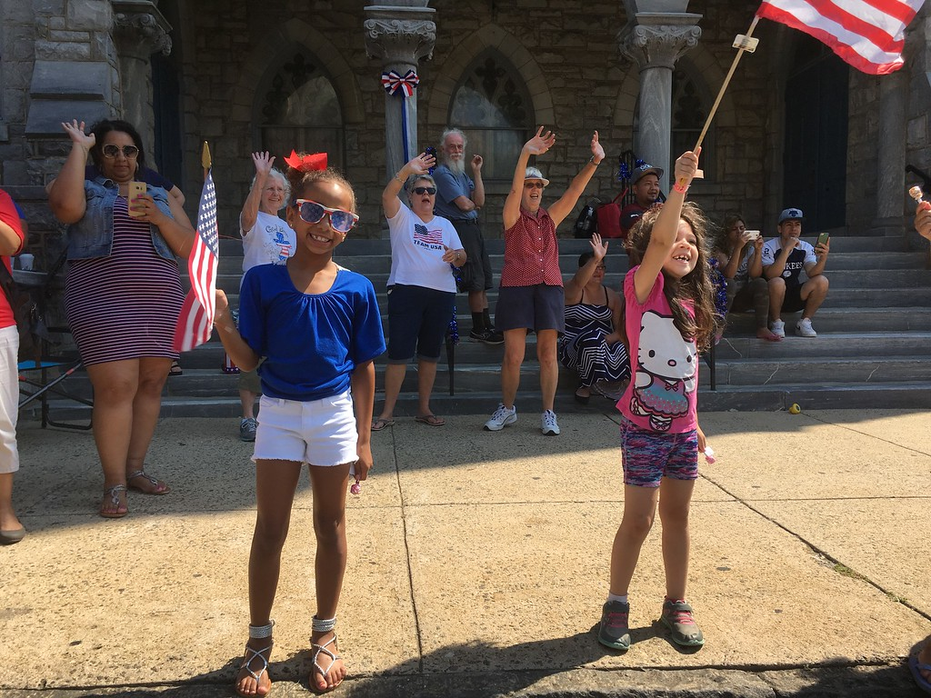 . Enthusiastic young spectators wave their flags on West Marshall Street during Norristown\'s Fourth of July Parade Tuesday, July 4, 2017. Joe Barron -- Digital First Media