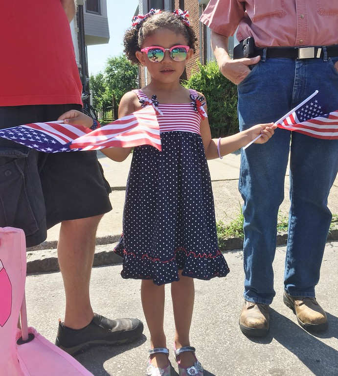 . Mykayla Harris, who will turn 4 this month, waves her flags as the Norristown Fourth of July Parade moves up Stanbridge Street Tuesday, July 4, 2017. Joe Barron -- Digital First Media