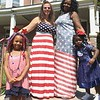 Wearing their most patriotic dresses, Stanbridge Street neighbors Kathleen Beatty, left, and Julia Mayes pose for a photos after the Norristown Fourth of July parade has passed through their neighborhood Tuesday, July 4, 2017. With them are their daughters, Bella Beatty, left, and Stori Mayes. Joe Barron -- Digital First Media